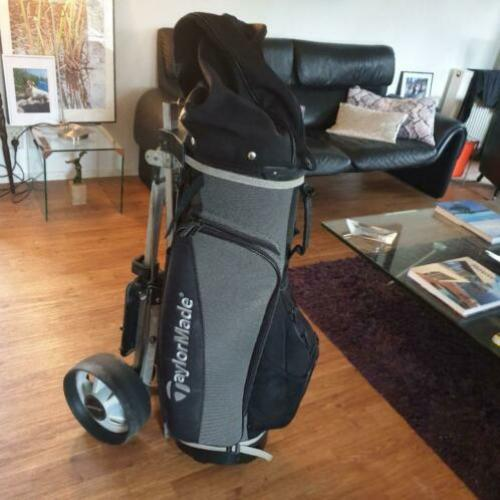 TaylorMade cartbag met Happy Golf trolley.